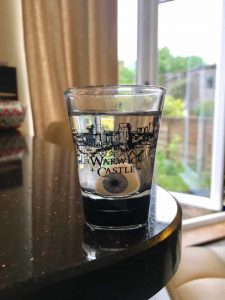 prosthetic eye in a shot glass