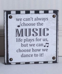 """Quote that says """"we cant always choose the music life plays for us but we can choose how we dance to it""""."""