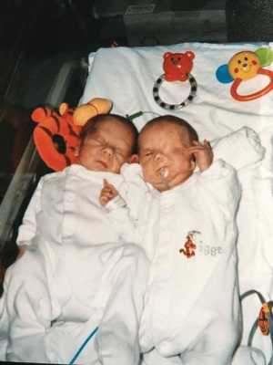 My premature boys reunited at a week old. Both in white baby grows with Tigger showing on Harrys - very apt